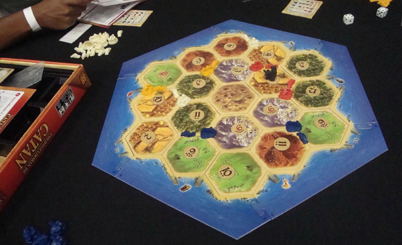 A Game of Catan Being Played