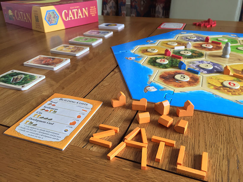 How to Play Catan - Orange Building Costs
